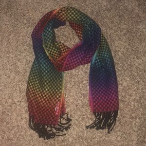 Rainbow patterned scarf with black tassels